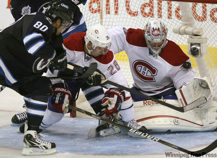 Nik Antropov scores the first NHL goal for the new Winnipeg Jets against Montreal goaltender Carey Price.