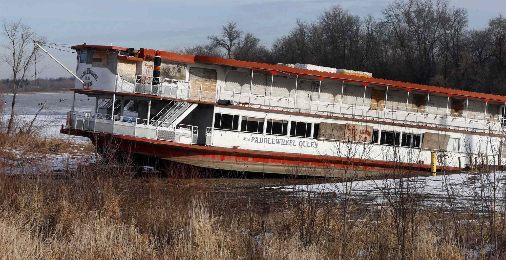 In 2015, the Paddlewheel Queen, the most stately of the Red River ships, is parked in a slough, awaiting to be dismantled and converted into a barge.