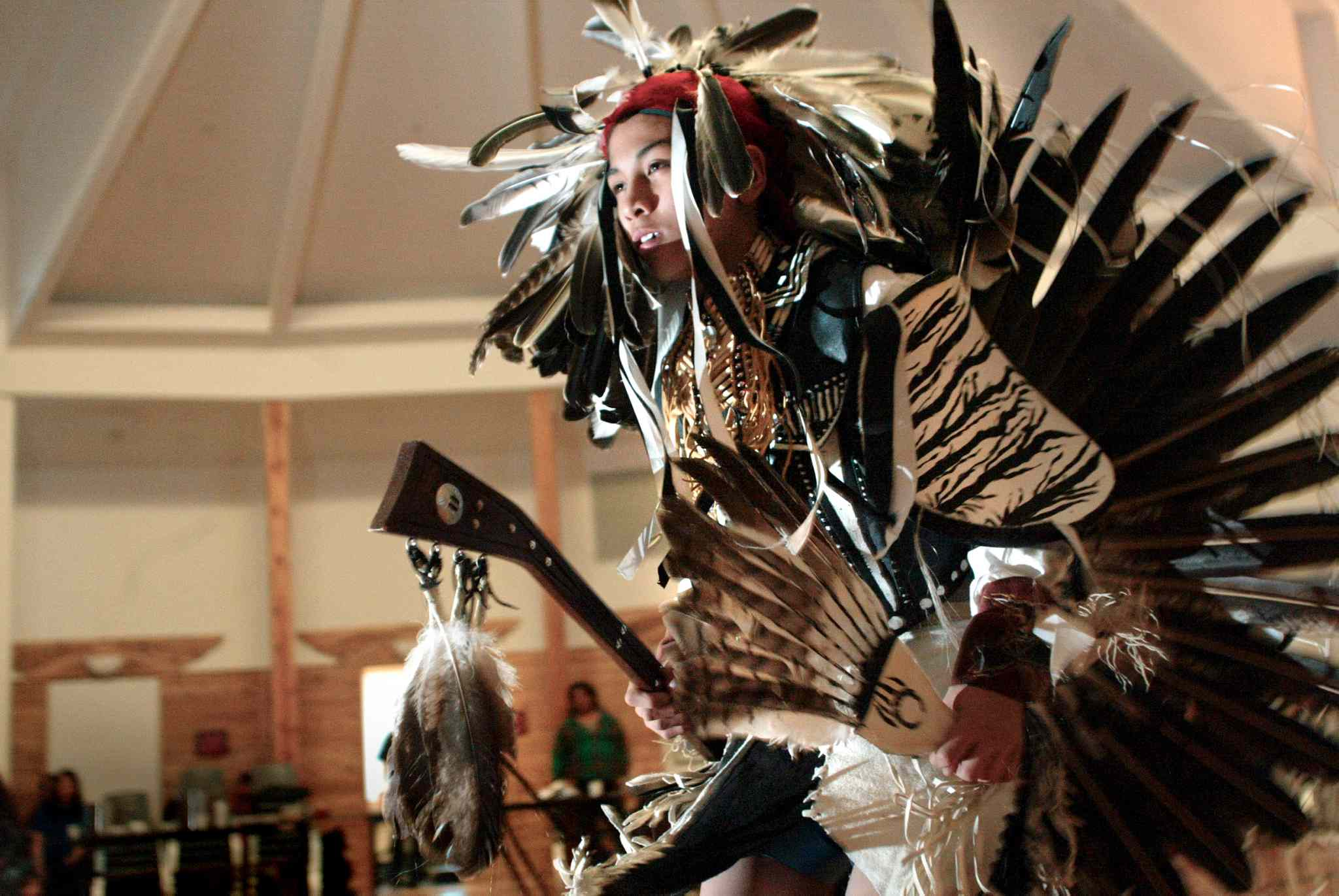 A young man performs a traditional dance celebrating the spring equinox at the Thunderbird House in Winnipeg in 2005.