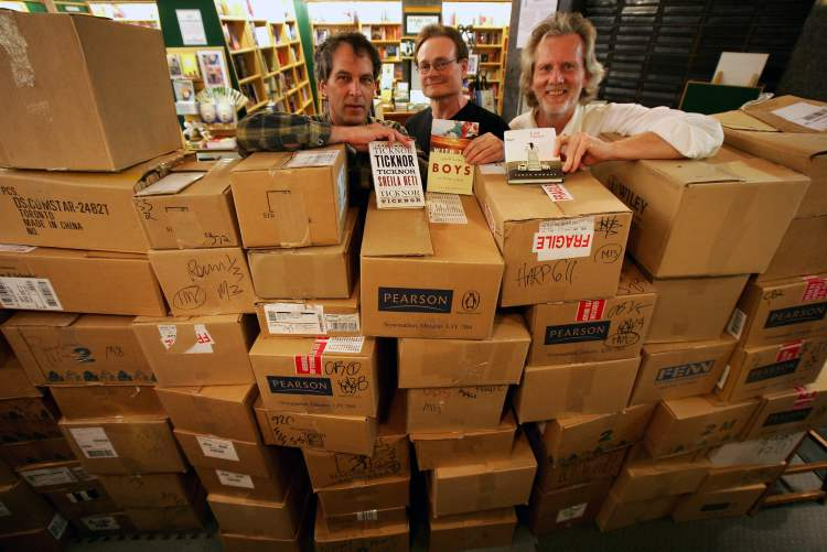 2005: From left: The Walrus editor, Ken Alexander, R.B. Russell teacher, Brian MacKinnon and R.B. Russell principle, Gary Comack, at the McNally Robinson bookstore in Portage Place Shopping Centre with boxes of books to be given to students in the inner city.  (MIKE DEAL / WINNIPEG FREE PRESS Archives)