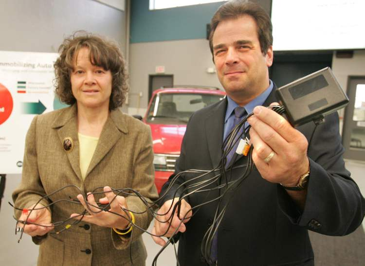MPI's Marilyn McLaren and CAA's Michael Mager with immobilizer in 2005.