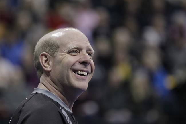Skip Kevin Martin smiles during the first end of the men's semi-final against John Morris at the 2013 Roar of the Rings Canadian Olympic Curling Trials in Winnipeg, Saturday, December 7, 2013. Former Olympic champion Martin is retiring from curling. THE CANADIAN PRESS/John Woods