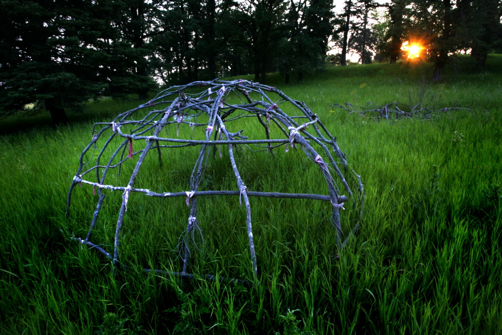 Abandoned sweat lodge frames at the Brandon Residential School.