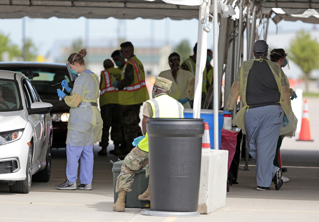 Fargo Cass Public Health and the North Dakota National Guard conduct COVID-19 drive-up testing for North Dakota State University staff and students, along with area K-12 teachers, in August at the Fargodome.(David Samson / Forum News Service files)