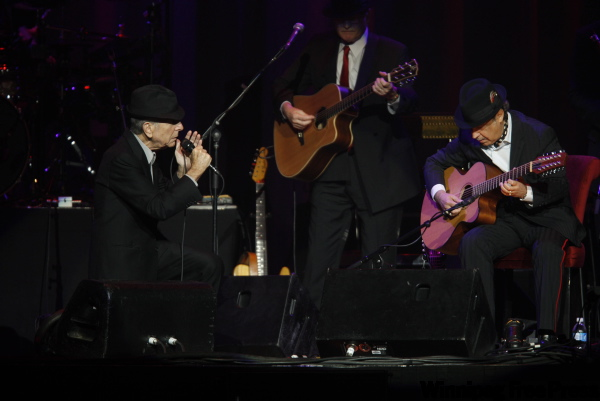 Leonard Cohen (left) jams with his band.