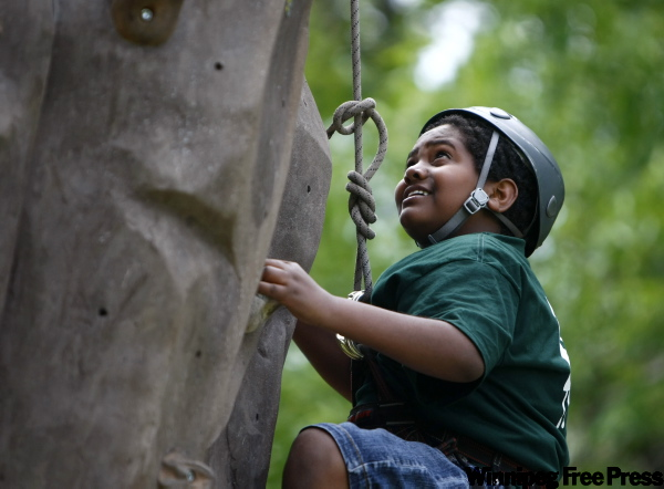 Ramy Omer, 16, a Daniel McIntyre student, tries the rock-climbing experience.