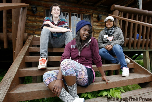 From left, Evan Monk, Yvette Nabulizi and Autumn Rain Taypayosatum, on the steps of one of the cabins, are from diverse backgrounds, but found they had plenty to share at camp.