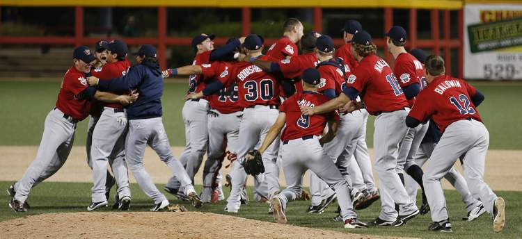 The Winnipeg Goldeyes celebrate after defeating the Wichita Wingnuts 8-3 in Wichita, Kansas Friday night. (Fernando Salazar / Wichita Eagle)