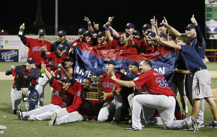 The Winnipeg Goldeyes pose with their trophy after winning the American Association Championship against Wichita Kansas Friday night.  (Fernando Salazar / Wichita Eagle)
