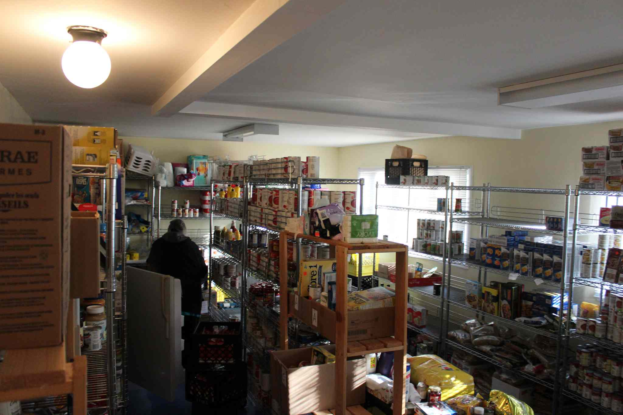 Shelves inside Thompson's only food bank, sponsored by the local Salvation Army, aren't yet full before Thanksgiving, which worried the ministry director.