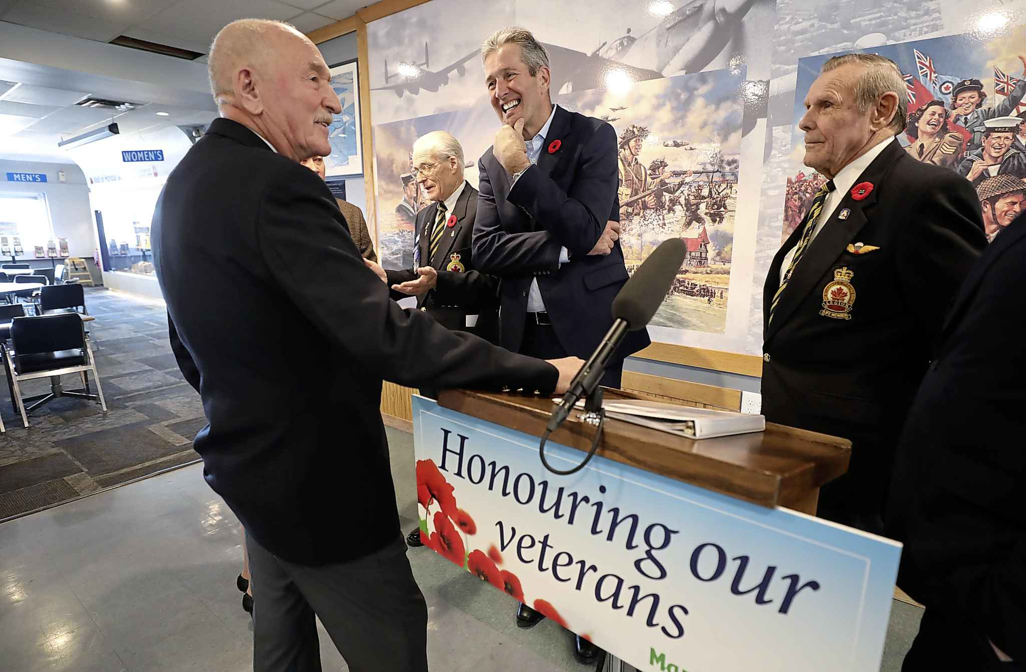 Premier Brian Pallister talks to Henderson branch Legion president, Fred Wilson (left), and other veterans, after holding press conference on the provincial government offering new support for veterans organizations on Thursday. (Ruth Bonneville / Winnipeg Free Press)