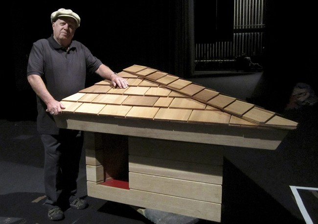 In this photo provided by Michael Miner, Jim Berger poses next to a dog house designed by Frank Lloyd Wright on Oct. 21, 2011, in Glendale, Calif. (AP Photo/Alisse Gratehouse)
