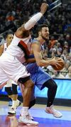 Denver Nuggets' Joffrey Lauvergne (77) shoots against Portland Trail Blazers' LaMarcus Aldridge, left, during the first half of an NBA basketball game in Portland, Ore., Saturday, March 28, 2015. (AP Photo/Greg Wahl-Stephens)