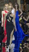 Model Eva Herzigova, left, walks the runway with a creation by Italian fashion designer Donatella Versace, as part of the Atelier Versace Spring Summer 2015-16 Haute Couture fashion collection in Paris, Sunday, Jan. 25, 2015. (AP Photo/Jacques Brinon)