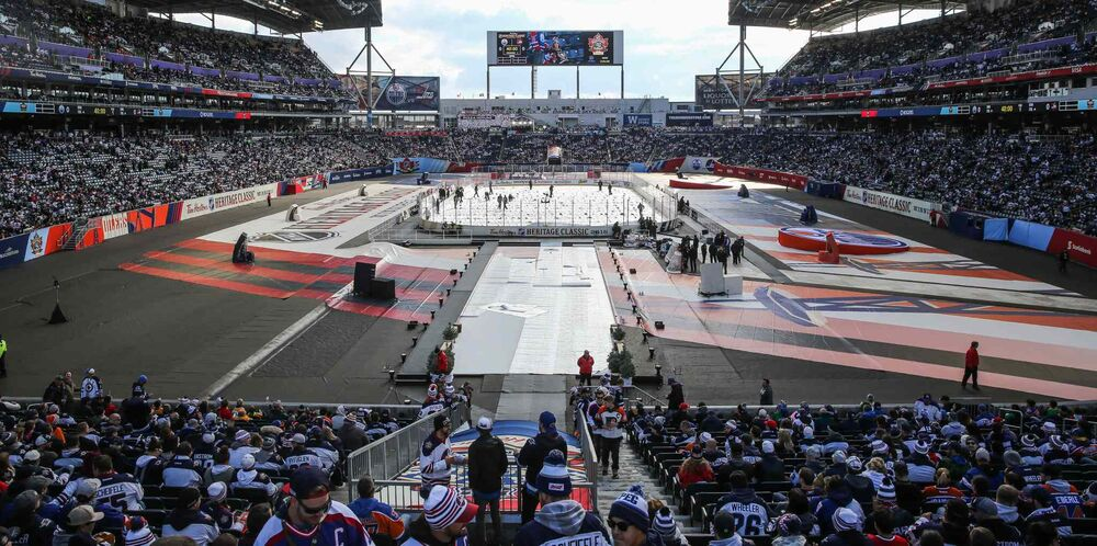 Fans start to make their way to their seats before the NHL game between the Winnipeg Jets and the Edmonton Oilers on Sunday. - MIKE DEAL / WINNIPEG FREE PRESS