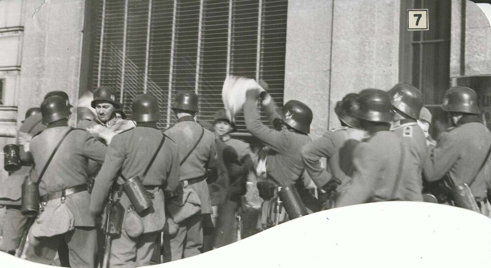 Nazi troopers surround a Free Press newsie, tear up his papers and scatter them on the street. - Winnipeg Free Press Archives