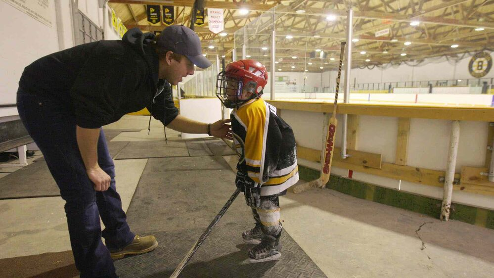 JOE BRYKSA / WINNIPEG FREE PRESS Rohan Pettinger with his father inside the arena after a long skate in Pierson, Man.
