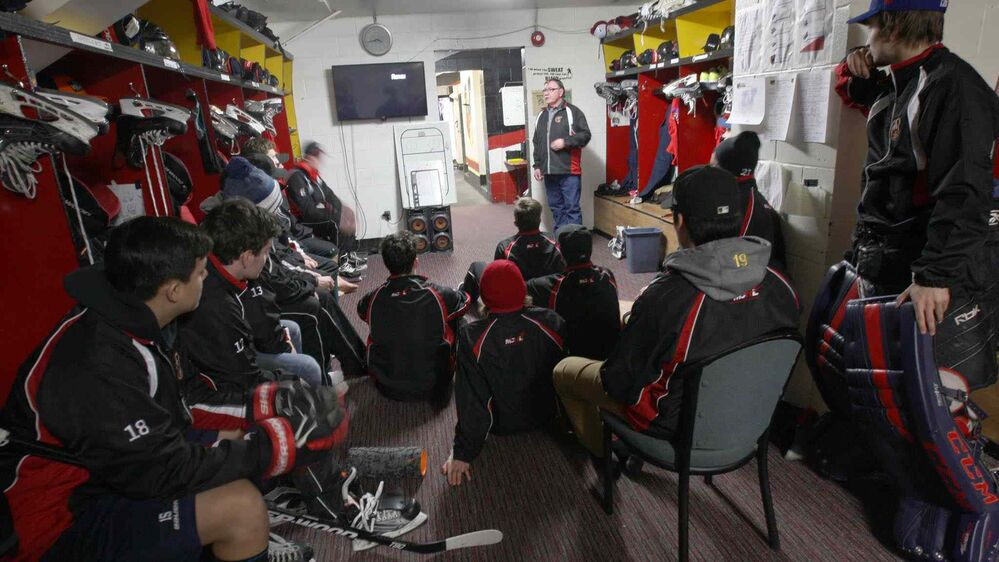 JOE BRYKSA / WINNIPEG FREE PRESS Waywayseecappo Wolverines head coach and general manager Barry Butler chats with his players.