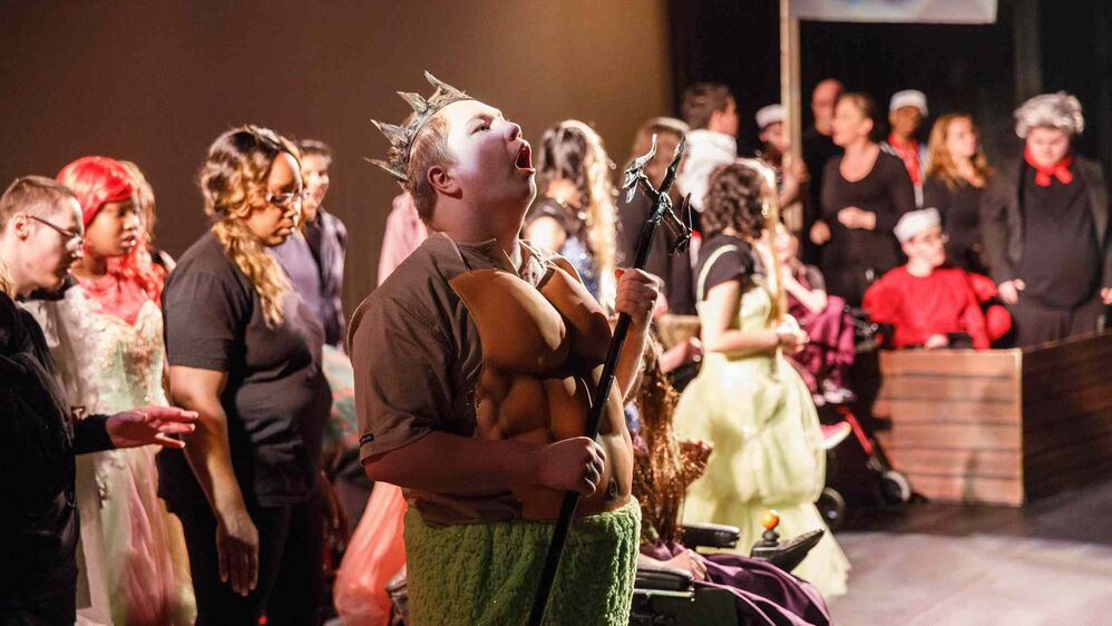 Jackson as King Triton and the rest of the cast on stage just before the curtain rises on The Little Mermaid. (Ruth Bonneville / Winnipeg Free Press)