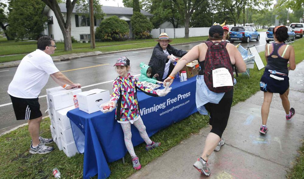 Snacks and refreshments are handed out to participants as they pass through the Check Stop along Grosvenor Avenue.<br>