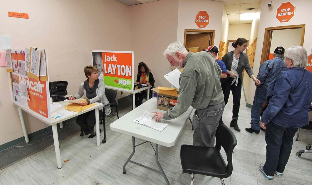Supporters for Pat Martin, NDP candidate for Winnipeg Centre, keep working at his campaign headquarters during the final moments of the federal election Monday evening.  - Mike Deal / Winnipeg Free Press