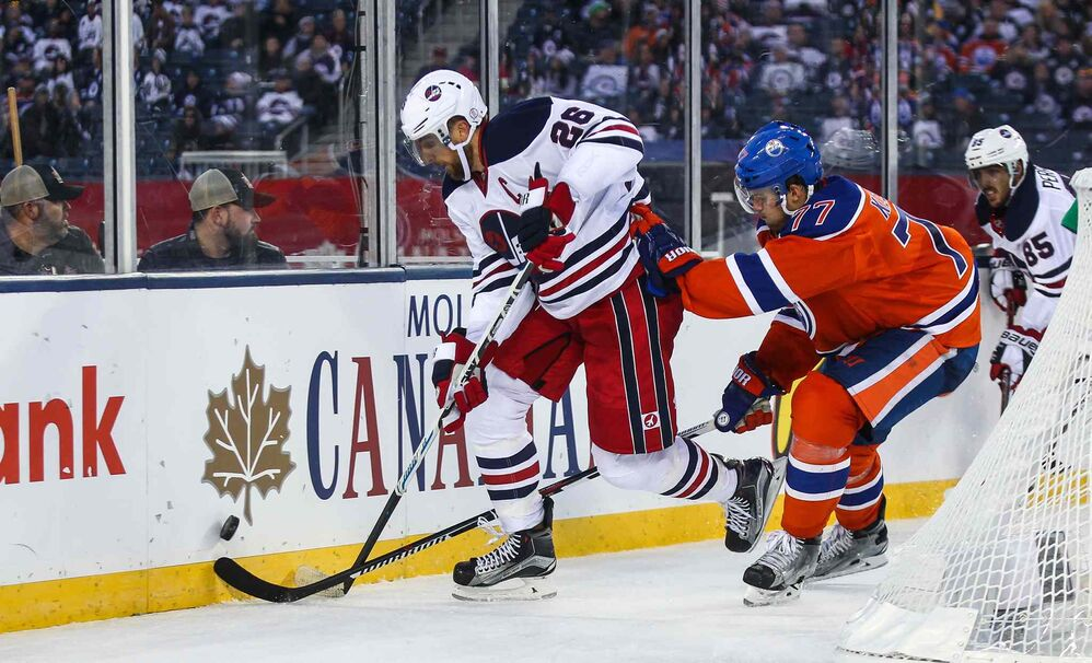 Winnipeg Jets' Blake Wheeler (26) keeps control of the puck behind Edmonton's net while being chased by Edmonton Oilers' Oscar Klefbom (77) during third period.  - MIKE DEAL / WINNIPEG FREE PRESS
