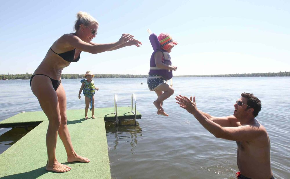 Gull Lake, Man. Scott and Kim Minty enjoy some lake time with their children Ella, and Ava. July 21, 2016  -