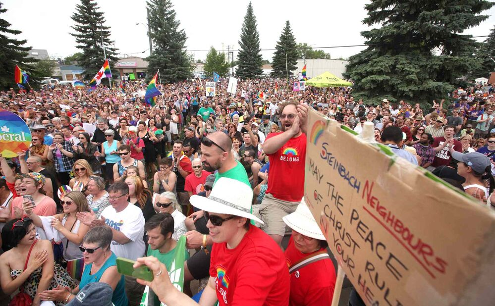 Thousands gather on the steps of City Hall. - RUTH BONNEVILLE / WINNIPEG FREE PRESS