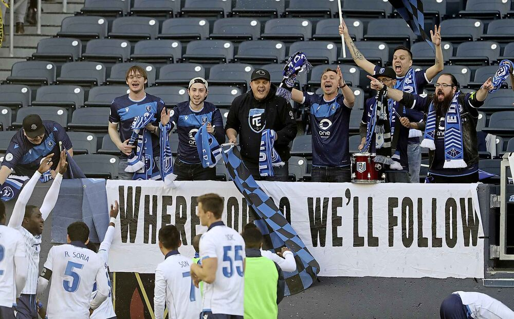FC Edmonton fans celebrate with the team after they defeat Valour FC.<br>