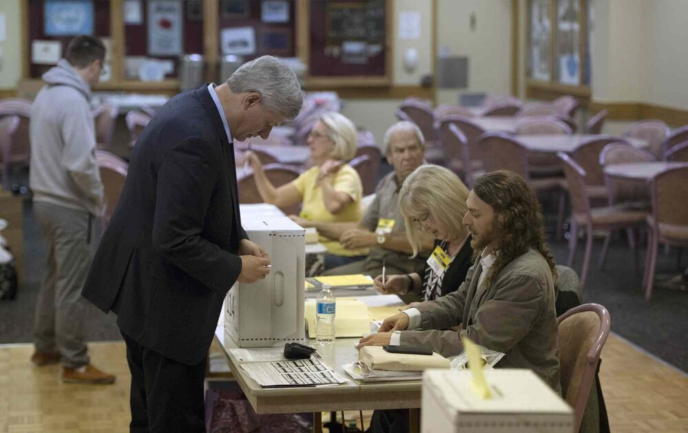 Conservative leader Stephen Harper casts his ballot at an Elections Canada poling station in Calgary Monday, Oct. 19, 2015.  THE CANADIAN PRESS/Jonathan Hayward - CP