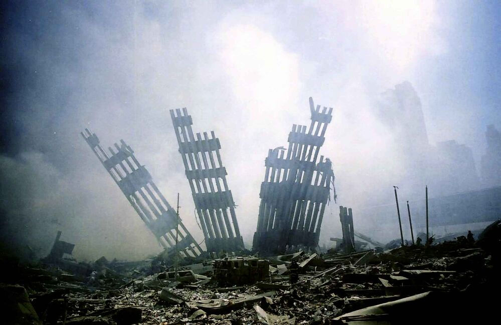 The remains of the World Trade Center stands amid the debris in New York, Tuesday, Sept. 11, 2001. (AP Photo/Alexandre Fuchs) -