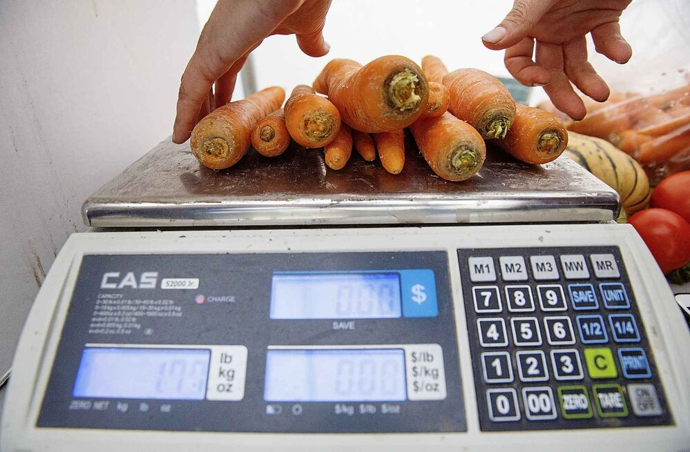Carrots are weighed.