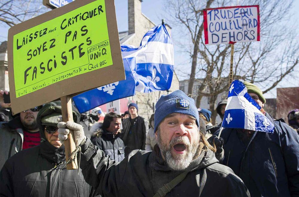 Protesters opposing motion M-103 demonstrate in Montreal. - GRAHAM HUGHES / THE CANADIAN PRESS