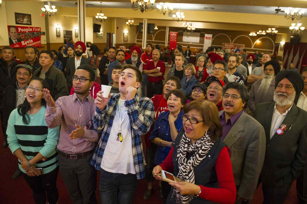 Supporters of incumbent Liberal Kevin Lamoureux watch election coverage on television at the Punjab Banquet Hall in his Winnipeg North riding Monday Oct.19, 2015. - DAVID LIPNOWSKI / WINNIPEG FREE PRESS