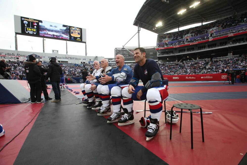 RUTH BONNEVILLE / WINNIPEG FREE PRESS  Winnipeg Jets Alumni players Kris King (front), Brian Mullen, Mike Ford and Jim Kyte (last) sit with teammates between first and second period.   -