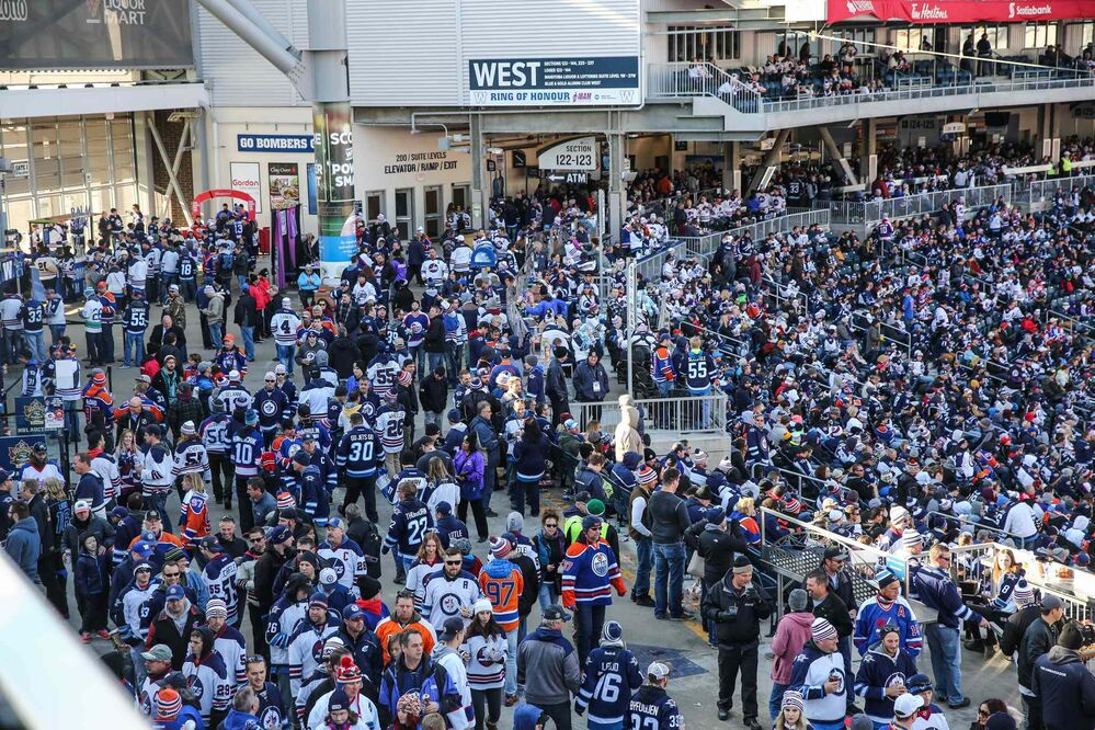 Fans make their way around the concourse prior to the start of the NHL game between the Winnipeg Jets and the Edmonton Oilers at Investors Group Field on Sunday. - MIKE DEAL / WINNIPEG FREE PRESS