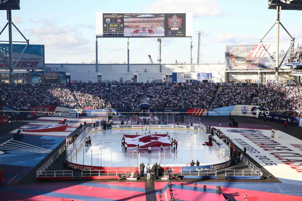 The Canadian flag is brought out to ice during the singing of O Canada prior to the start of the NHL game between the Winnipeg Jets and the Edmonton Oilers at Investors Group Field. 161023 - Sunday October 23, 2016 - MIKE DEAL / WINNIPEG FREE PRESS