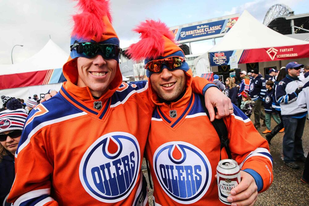 Conway Nelson (left) and Nathan Knezacek from Regina were among  hundreds of fans gathered at the Spectator Plaza across the street from Investors Group Field on Sunday before the NHL game between the Winnipeg Jets and the Edmonton Oilers. - MIKE DEAL / WINNIPEG FREE PRESS