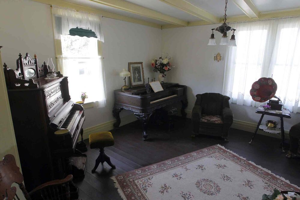 This is the white house where Nellie McClung lived. This room on the main floor houses two musical instruments.(Boris Minkevich / Winnipeg Free Press)
