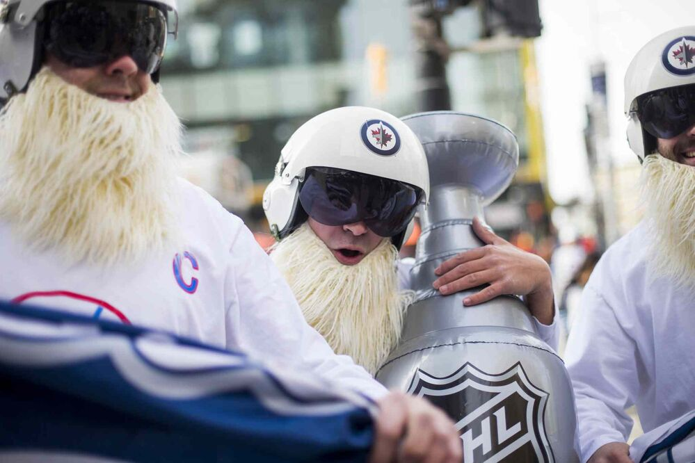 MIKAELA MACKENZIE / WINNIPEG FREE PRESS<br>Cody Laschyn (centre) and friends Normal Lavallee (left) and Tyler MacFarlane wait for the Jets whiteout party get started on Donald Street in Winnipeg on Wednesday, April 11, 2018.<br> Mikaela MacKenzie / Winnipeg Free Press 2018.