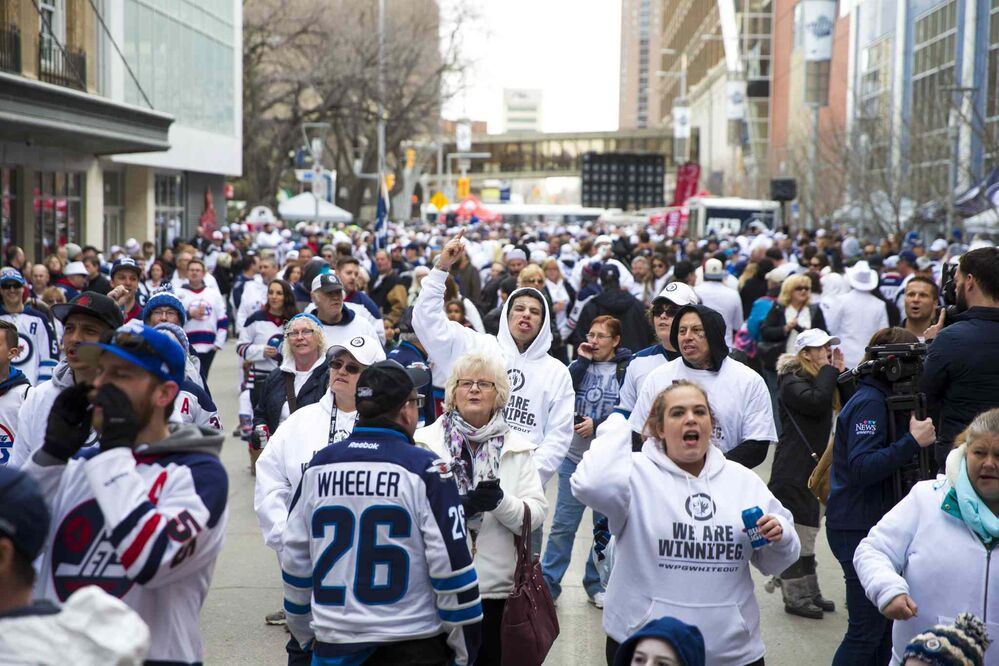 MIKAELA MACKENZIE / WINNIPEG FREE PRESS<br>The Jets whiteout party get started on Donald Street in Winnipeg on Wednesday, April 11, 2018.<br>