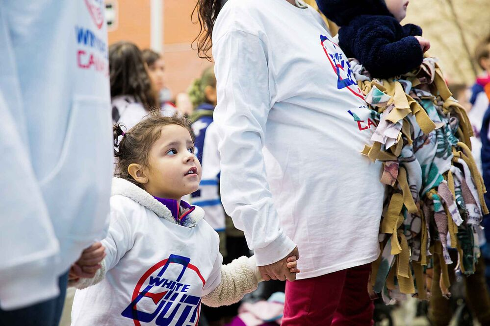 MIKAELA MACKENZIE / WINNIPEG FREE PRESS<br>Zarayah Richards, 3, stands for the national anthem at the Jets whiteout party.<br>