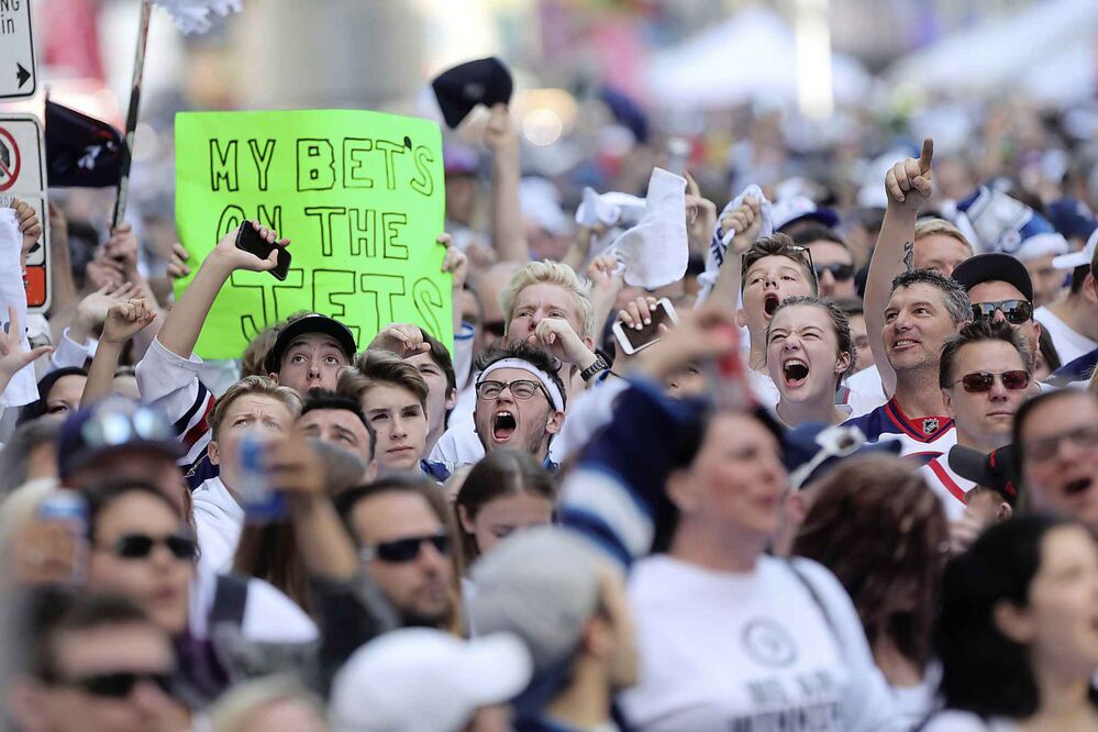 RUTH BONNEVILLE / WINNIPEG FREE PRESS<br>Thousands of Winnipeg Jets fans scream at the start of Game 1 of Western Conference final between the Jets and Las Vegas Golden Knights game outside Bell MTS Place druing the Whiteout street party Saturday, May 12, 2018.<br>
