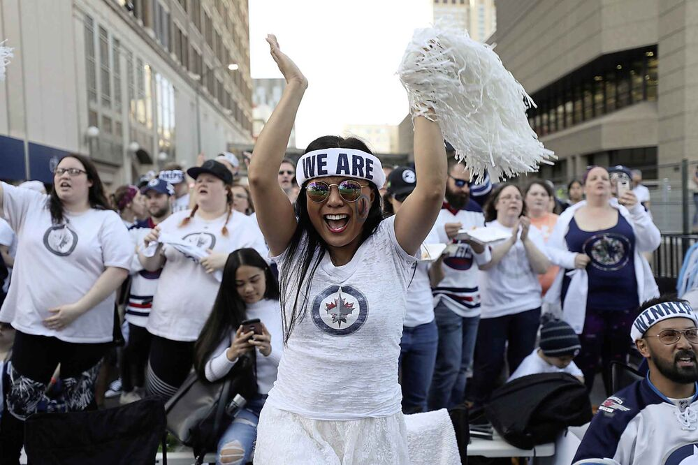 RUTH BONNEVILLE / WINNIPEG FREE PRESS<br>Melanie Ilag dances to the music of Big City All Star Band on stage at the Whiteout street party just prior to the start of Game 1 of the Western Conference final between Winnipeg Jets and Las Vegas Golden Knights Saturday, May 12, 2018.<br>