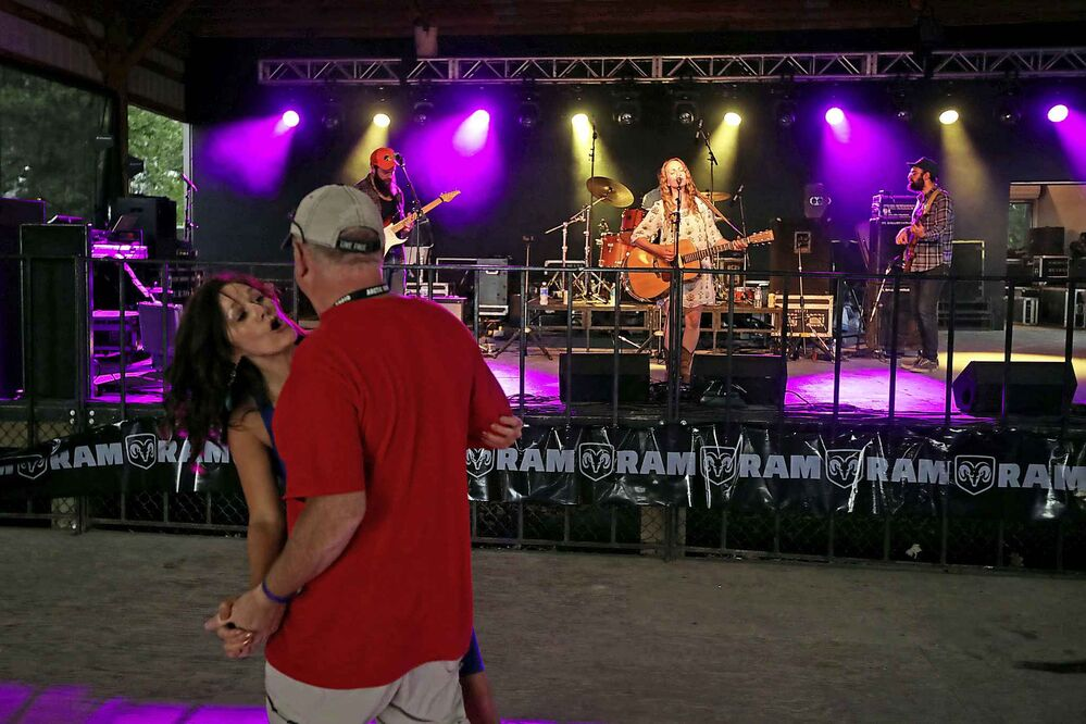 A couple dances as Kayla Luky performs at Dauphin's Countryfest Friday. (Tim Smith / The Brandon Sun)