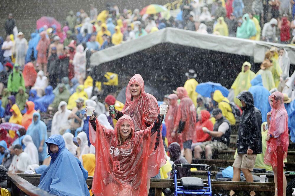 Country music fans wait out the rain at the mainstage during a downpour at Dauphin's Countryfest Friday. (Tim Smith/The Brandon Sun)
