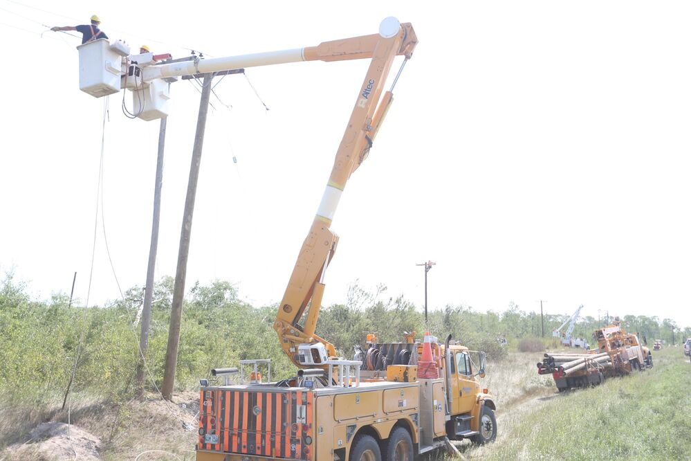 Manitoba Hydro crews worked to replace six poles just outside of Alonsa on Saturday after the tornado hit.  - Melissa Verge/The Brandon Sun