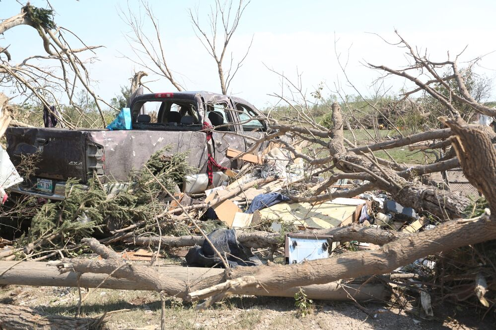 Some of the destruction at the home of Jack Furrie, who was killed in the tornado, is seen on Saturday. - Melissa Verge/The Brandon Sun