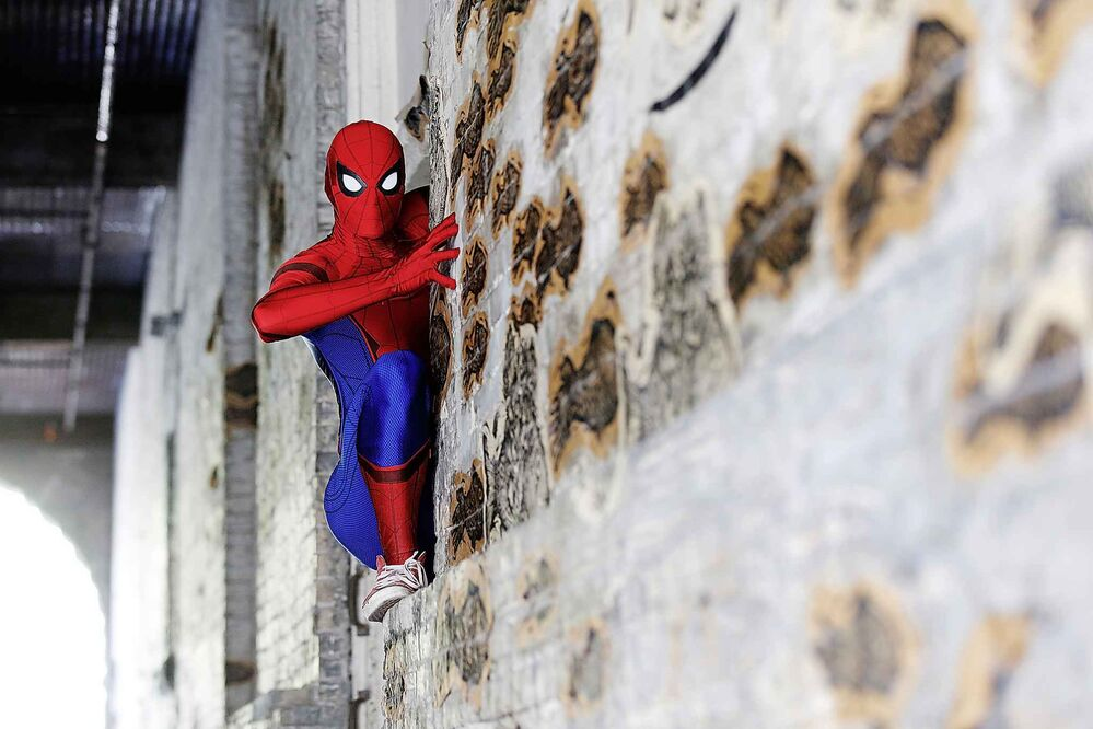 JOHN WOODS / WINNIPEG FREE PRESS  Winnipeg's Spider-Man has fun putting a smile on people's faces and helping out whenever he can.