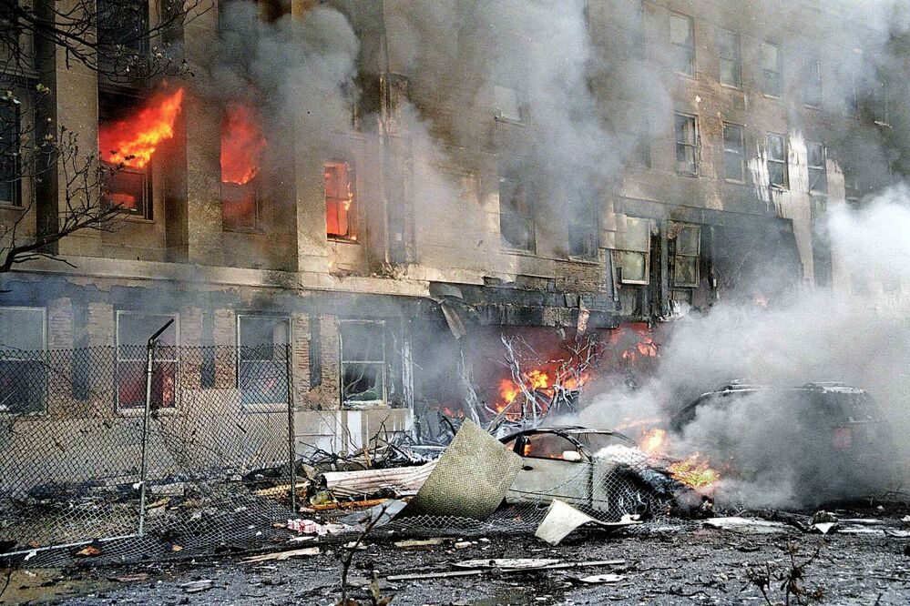 Flames and smoke pour from a building at the Pentagon in Washington on Tuesday, Sept. 11, 2001. (AP Photo/Will Morris) -